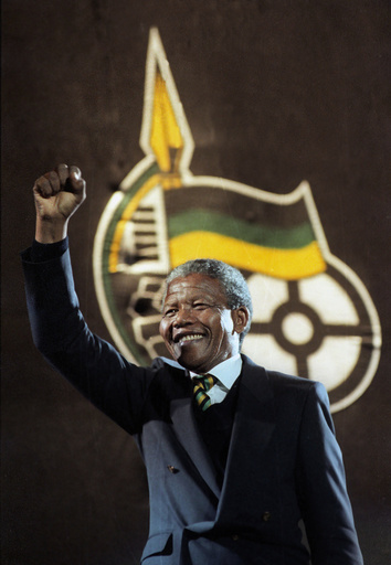 File photo of Nelson Mandela raising his fist as he walks on stage at Wembley Arena in London