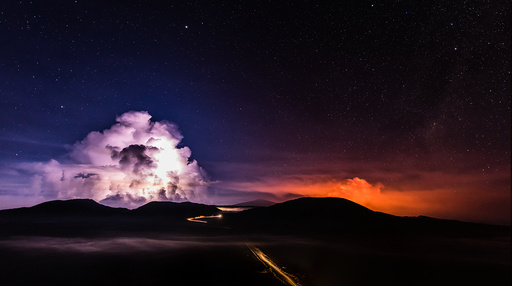 A long time exposure shows molten lava which flows from the Piton de la Fournaise, one of the world's most active volcanoes, on the French Indian Ocean Reunion Island