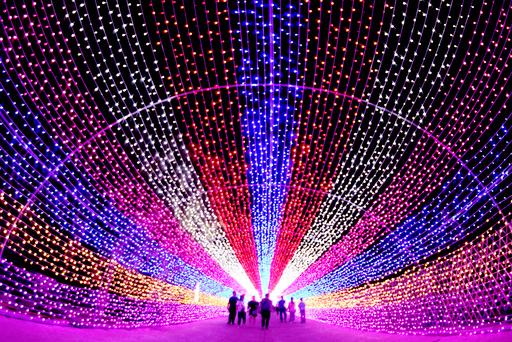 Tourists walk through a lantern installation in Zhangjiakou