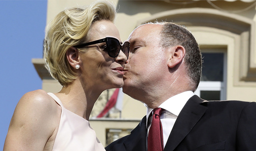 Prince Albert II of Monaco and his wife Princess Charlene embrace during the celebration of the 10th anniversary of the Prince's accession to the throne in Monaco