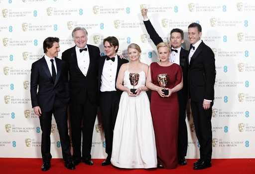 Jonathan Sehring, Ellar Coltrane, Cathleen Sutherland, Patricia Arquette Ethan Hawke, and John Sloss celebrate after they won the best film award for