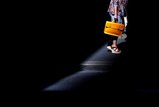 A shopper carries a bag as she walks through the CBD in Sydney