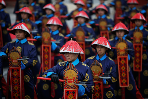 Performers take a part in a re-enactment of an ancient Qing Dynasty ceremony as the Lunar New Year of the Rooster is celebrated at the temple fair at Ditan Park (the Temple of Earth), in Beijing
