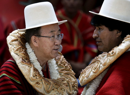 U.N. Secretary-General Ban Ki-moon talks with Bolivia's President Evo Morales during the inauguration of a sports arena called