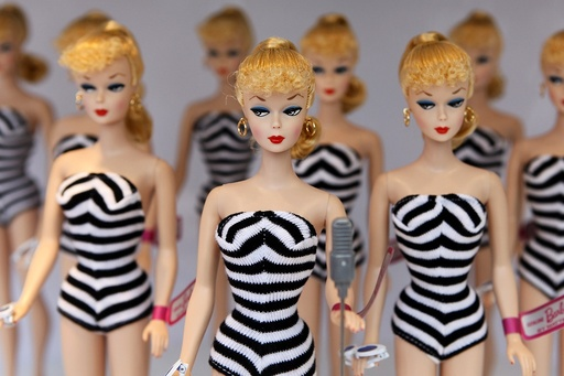 Barbie dolls sit on a display before the Barbie house opening ceremony in Shanghai