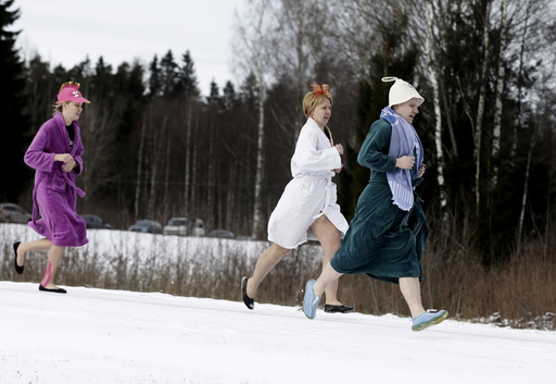 People run to the next sauna during sauna marathon near Otepaa