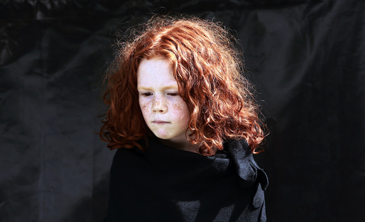 Maggie Noonan, 7, poses for a portrait during the Irish Redhead Convention in the village of Crosshaven in County Cork