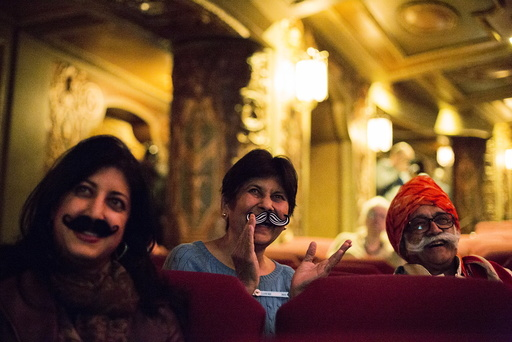 Ramesh Parekh and family watch contestants at the 2015 Just For Men National Beard & Moustache Championships at the Kings Theater in the Brooklyn borough of New York