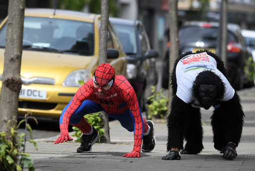 Charity event competitor, Tom Harrison, is joined by local a local resident and former world record holder for quickest Marathon time in fancy dress, as he continues his crawl in a gorilla outfit to raise money for the Gorilla Foundation