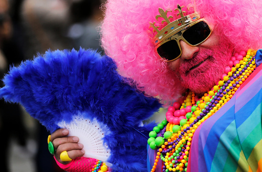A participant poses during the annual Belgian LGBT Pride Parade in central Brussels