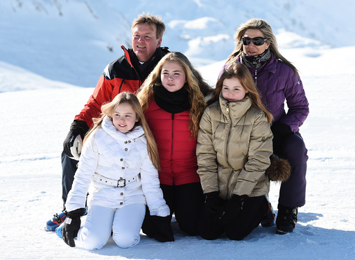 King Willem-Alexander and Queen Maxima of the Netherlands pose with their daughters in Lech am Arlberg