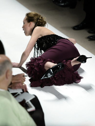 MODEL FALLS ON RUNWAY DURING SHOWING OF OSCAR DE LA RENTA FALL/WINTER 2004 COLLECTION.