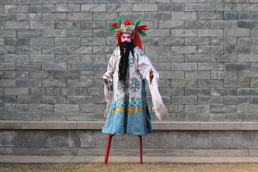 A performer wearing costumes walk on stilts before a show during a lantern fair at the beginning of Chinese Lunar New Year, in Xi'an