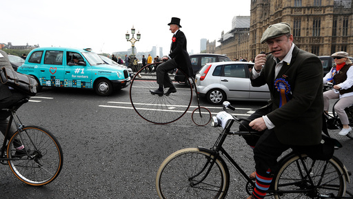 Participants in The Tweed Run cycle ride across Westminster Bridge in London