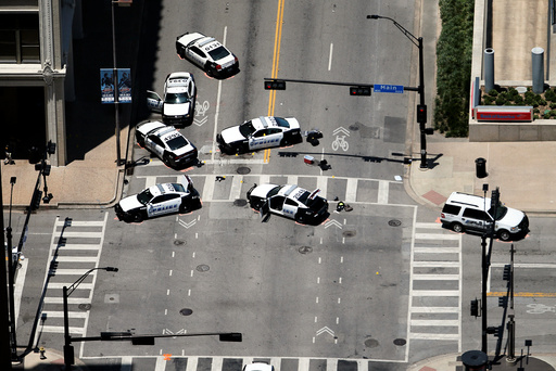 Law enforcement personnel investigate a mass shooting scene at El Centro Community College at the intersection of N Lamar St. and Main St. after an attack which killed and wounded Dallas police officers, in Dallas