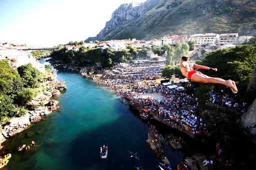 A man jumps from the Old Bridge during 450th traditional diving competition in Mostar
