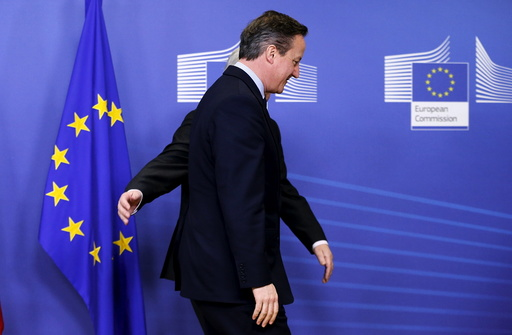 Britain's PM Cameron is welcomed by EU Commission President Juncker in Brussels