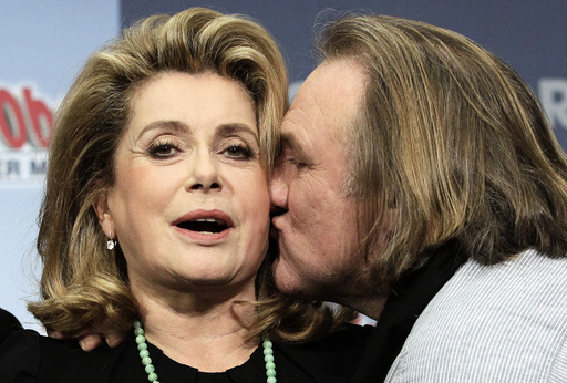 Actors Depardieu and Deneuve pose to promote movie in Berlin