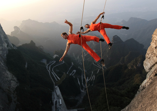 A dance group performs on the cliffs in Zhangjiajie