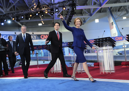 Carly Fiorina, Scott Walker, Jeb Bush, Donald Trump and other candidates take the stage for the Republican presidential debate in Simi Valley, Calif.