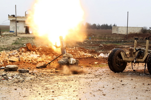 Free Syrian Army fighter fires a shell towards Islamic State fighters in the northern Aleppo countryside, Syria