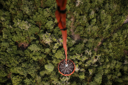 An Mi-17 helicopter carries water to be dumped on a burning forest at Ogan Komering Ulu area in Indonesia's south Sumatra province