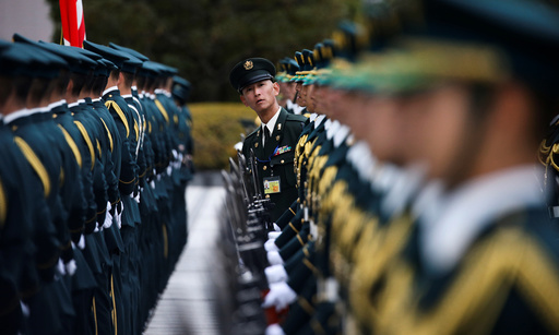 Members of Japan's Self-Defence Force's honour guard prepare for a ceremony for U.S. Defense Secretary Carter at the Defense Ministry in Tokyo