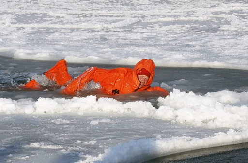 Britain's Prince Harry swims in icy water as he wears an immersion suit on the island of Spitsbergen, between the Norwegian mainland and the North Pole