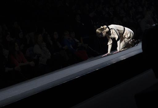A model falls as she presents a creation from designer Miguel Palacio's Fall/Winter 2012 collection during the Mercedes-Benz Fashion Week in Madrid