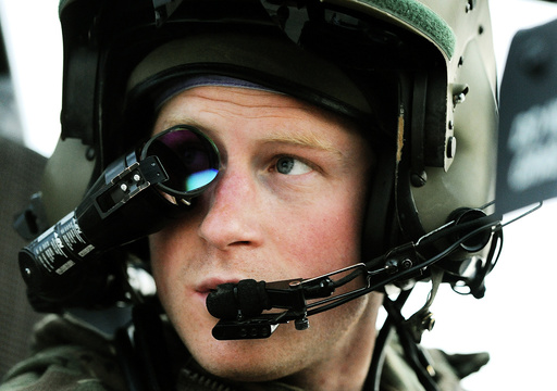 Britain's Prince Harry wears his monocle gun sight as he sits in his Apache helicopter at Camp Bastion, southern Afghanistan