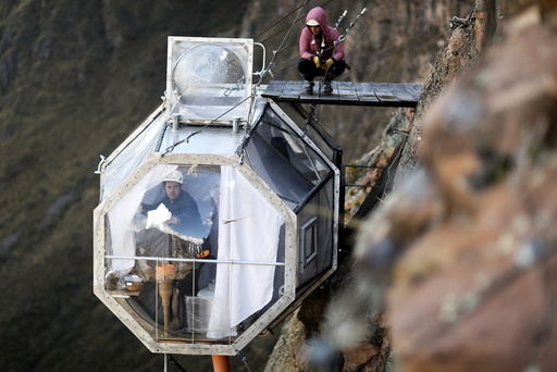 A guest cleans the inside of a sleeping pod at the Skylodge Adventure Suites in the Sacred Valley in Cuzco