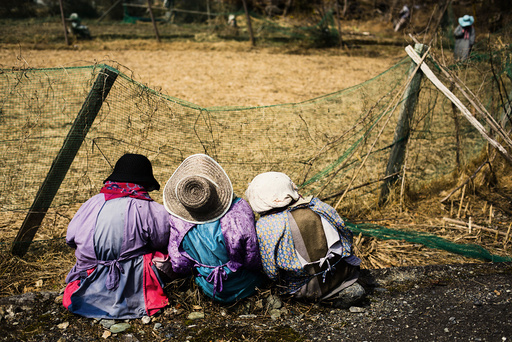 Scarecrows sit in at edge of a field in mountain village of Nagoro