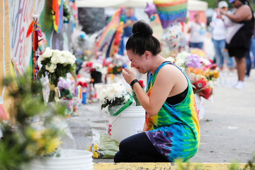 Nylen reacts while visiting the memorial outside the Pulse Nightclub on the one-year anniversary of the shooting in Orlando