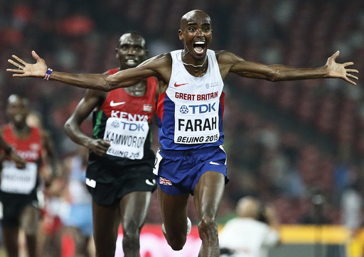 Farah of Britain reacts after winning the men's 10000m event during the 15th IAAF World Championships at the National Stadium in Beijing
