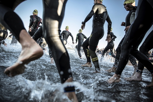 Triathletes take part in the 3800 m swimming leg of the KMD Ironman Copenhagen 2015 in Copenhagen