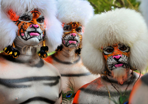 Men dressed as tigers wait to perform during celebrations to mark the Navratri festival, during which devotees worship the Hindu goddess Durga, in Mangaluru
