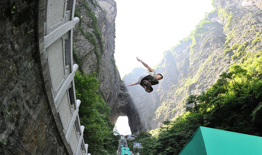 Contestant takes part in a parkour competition at Tianmen mountain, in Zhangjiajie, Hunan