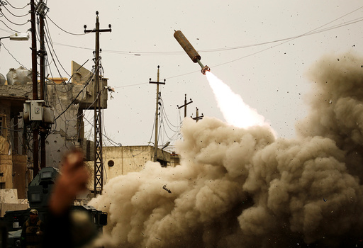 Iraqi rapid response members fire a missile against Islamic State militants during a battle with the militants in Mosul