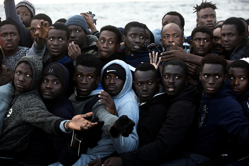 Sub-saharan migrants are seen aboard an overcrowded raft during a rescue operation by the Spanish NGO Proactiva Open Arms in the central Mediterranean Sea, 21 miles north of the coastal Libyan city of Sabratha