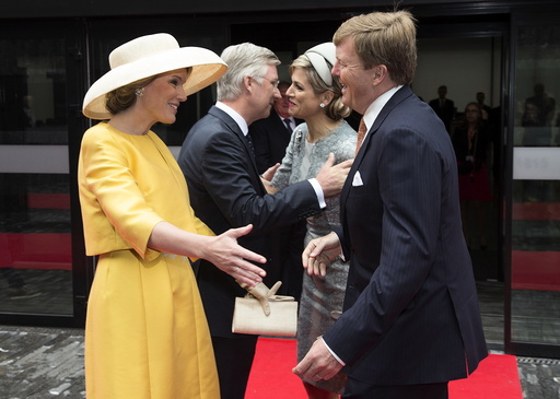 Netherlands' Queen Maxima and King Willem Alexander are welcomed by Belgium's King Philippe and Queen Mathilde ahead of a ceremony as part of the bicentennial celebrations for the Battle of Waterloo in Waterloo