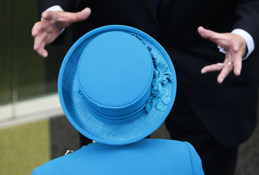 Britain's Queen Elizabeth in discussion with a guest at The University of Surrey's new School of Veterinary Medicine, Guildford, Britain.