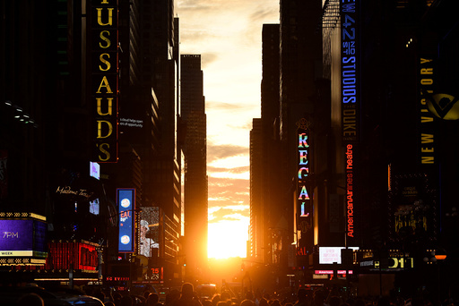 The sun sets over Manhattan, aligned exactly with the streets in a phenomenon known as Manhattanhenge