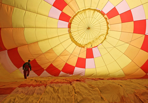 A man prepares a hot air balloon during the 2nd Hot Air Balloon Carnival in Nanjing