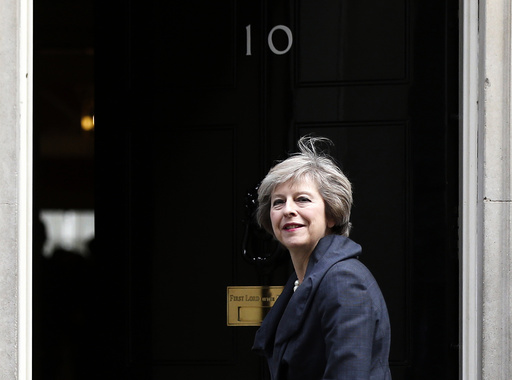 Britain's Home Secretary Theresa May, who is due to take over as prime minister on Wednesday, arrives for a cabinet meeting at number 10 Downing Street, in central London, Britain