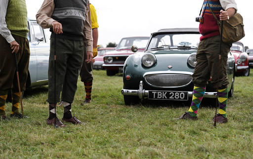 Visitors and car enthusiasts attend the annual Goodwood Revival historic motor racing festival, celebrating a mid-twentieth century heyday of the racing circuit, near Chichester in south England