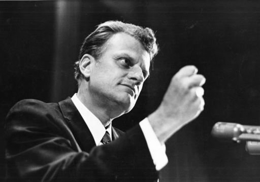 The Rev. Billy Graham speaks to an audience of police officers at the Waldorf Astoria Hotel in New York in May 1969.