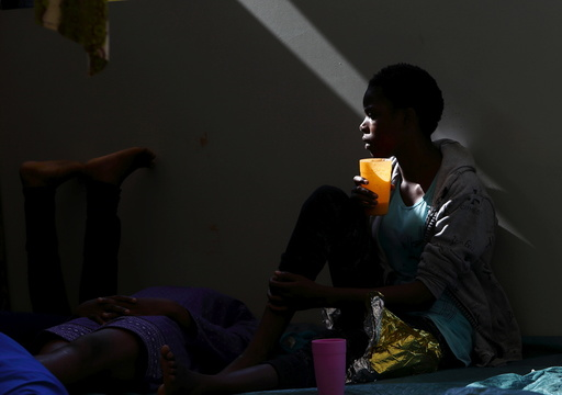 A migrant drinks water on the deck of the Medecins san Frontiere (MSF) rescue ship Bourbon Argos somewhere between Libya and Sicily