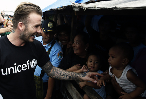David Beckham greets victims of super Typhoon Haiyan at an evacuation centre in Tacloban city in central Philippines