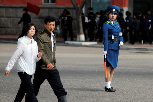 People cross the street in central Pyongyang, North Korea