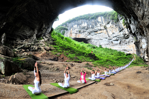 Yoga enthusiasts practice yoga at Yueyan Cave during session organised by yoga club in Daoxian